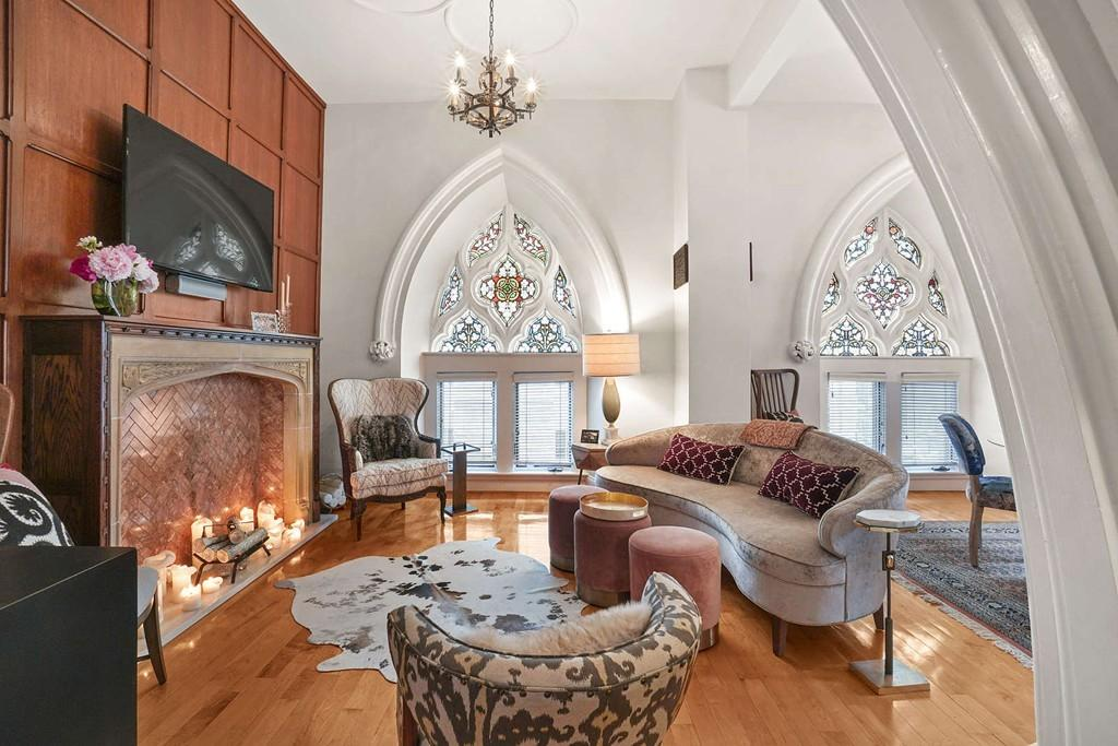 See inside a condo in a former South Boston church with stunning stained-glass windows