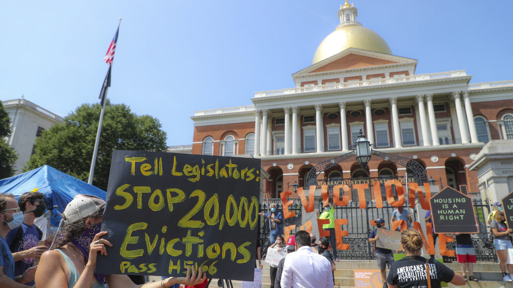 Protesters at a rally in support of bills to block evictions in Massachusetts for up to a year.